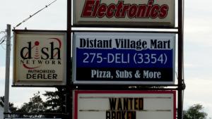 Distant Village Mart Backlit Sign Face